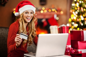 Beautiful woman shopping online for Christmas.